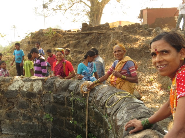 Women drawing water at the village well